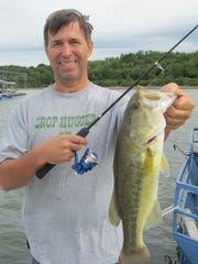 Brad White with a big bass, displays how to hold the