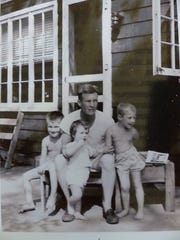 A younger Dick Dierker poses with three of his four children; Richard, David, Deborah, and Diana, who is deceased.