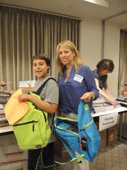 Josh Weintraub, 12, and Racquel Weintraub of Ardsley were among the volunteers who filled 1,300 new backpacks with school supplies for children in need at UJA-Federation of New York's annual Supplies for Success backpack assembly event on Aug. 9. Supplies for Success, now in its 15th year, has helped 46,000 students by sending them back to school with the tools they need to have a successful year. The backpacks will be distributed through the Educational Alliance, the Jewish Board, JCCA, Jewish Community Center of Staten Island, New York Legal Assistance Group and Lawyers for Children.