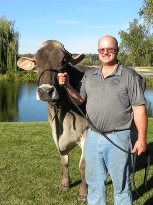 "In 2013 Allan Bassler brought his highly prized veteran of World Dairy Expo ""Snickerdoodle"" back to Madison at the ripe old age of 15. His special bond with his aged Brown Swiss cow, a former Supreme Champion and two-time Reserve at Expo was evident. She is one of the record breakers we remember on the 50th anniversary of Expo."