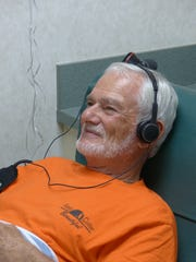 Jim Zimmerman listens to a talk show as he donates platelets on Oct. 12, 2016 at the Community Blood Center in Naples. He has donated more than 100 gallons of platelets at the center.
