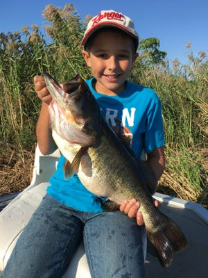 Ethan Shellen, 8, caught and released his biggest bass to date, an 8-pound sow, while fishing Nov. 17 with his dad, Nathan and granddad Mike.