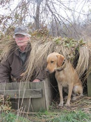 Duck hunter Loel Wilson and his dog, Trace, take a