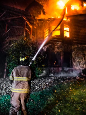 DO NOT USE THIS PHOTO....MARCIA member of the Gatlinburg Fire Department battles a fire at a building at the Westgate Smoky Mountain Resort on Tuesday, Nov. 29, 2016.