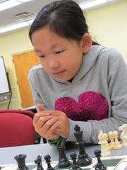 Nicole Xie is the picture of concentration during a match against Daniel Han.