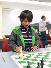 Rishaan Gorde is contemplative after a move by his opponent Aayan Mehta.