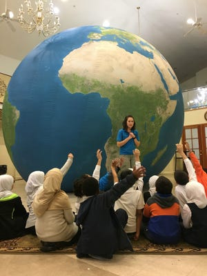 Becca Virden of the Delaware Children's Museum conducts a presentation to third-grade students.