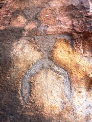 This anthropomorphic petroglyph is etched in basanite
