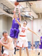TCA's Vann Bryant shoots over South Gibson's Gabe Martin earlier this season.
