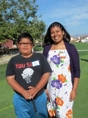 Iris Cruz, with mentee Jorge Silva in 2012 on campus at The First Tee Monterey County in Salinas.