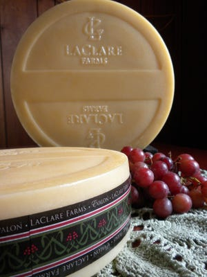 Women vying for Wisconsin bachelor Nick Viall's heart competed in a race, featuring a 10-pound wheel of LaClare's U.S. Cheese Championship- winning Evalon.