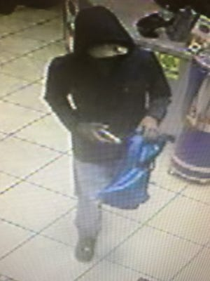 Police are searching for a suspect in an armed robbery at a business in Opelousas Thursday night.