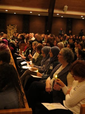 Muslim and Jewish women and their families join in common prayer at the unity rally on Feb. 16 in Chatham.
