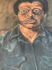 A self-portrait of Robert Busby, owned by his daughter Ena, hangs in the former Creole Gallery, now a restaurant on Feb. 23, 2017.