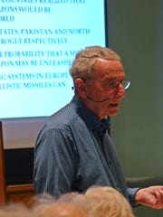 Dr. John Psaras, former chief scientific officer with the U.S. Department of Energy, talks about nuclear weapons and terrorism during his lecture at Unitarian Universalist Congregation of Greater Naples on Feb. 22, 2017.