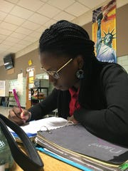 Naomi Odeyinde, a sixth-grader, works on math homework during an after-school program at Kirk Middle School.