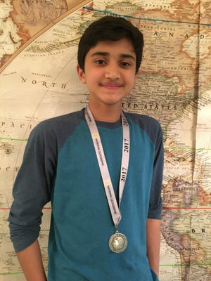 Rohan Kanchana, an 8th grader from Newark Charter School, won the Delaware State Geography Bee.