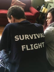 Justin Farmer wears a t-shirt given to him by the crew