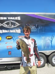 Doug Guidorzi, Rockwood High School, Fenton, Mo. with the only smallmouth bass checked in on Saturday of the Teen Anglers Tournament.