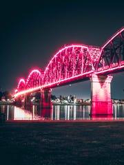 Big Four Bridge lit up at night in Louisville.