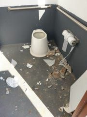 Inside of the damaged latrine at Widow Coulee FAS on Missouri River downstream from Great Falls.