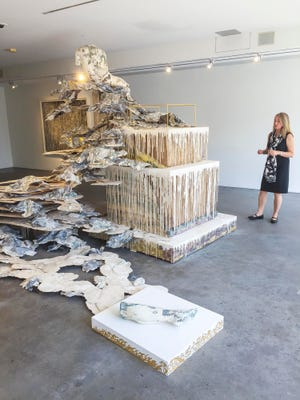 "Heather Ferrell, Curator and Director of Exhibits at Burlington City Arts, discusses ""Phantom Limb"", a work in the exhibit ""Immaterial"" by Diana Al-Hadid in Burlington on Tuesday, August 8, 2017."