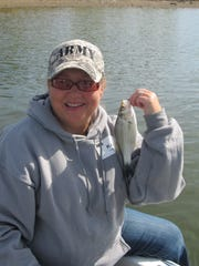 Koi Law with a small white bass she caught during the