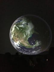 The Earth is projected on the dome of McCullough Middle School's new planetarium.