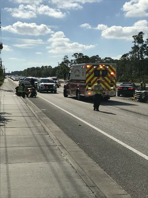 Martin County Fire Rescue workers treat a patient n Nov. 26, 2017 following a two-car collision on Kanner Highway northbound, south of Pomeroy Street in Stuart.