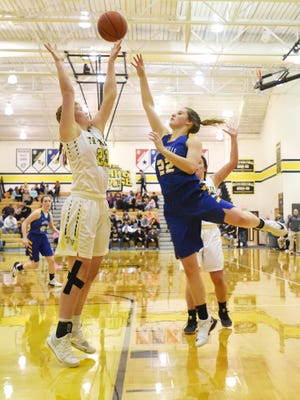 Maysville's Macie Jarrett puts up a shot over Tri-Valley's Alysa Edwards-Frick earlier this season. The Panthers earned the second seed in Division II in the East District, and the Scotties were the 12th seed in Division I in the Central District.