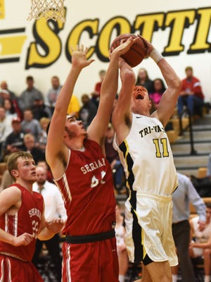 Jake McLoughlin goes up in the lane against Grant Heileman during Tri-Valley's 58-50 win against visiting Sheridan on Saturday in Dresden. McLoughlin finished with 10 points and 14 rebounds as the Scotties remained tied atop the Muskingum Valley League standings.
