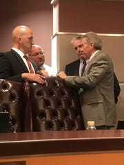 Senior Assistant City Attorney Phil Mugavero (white shirt) confers with Mayor Greg Oravec, Interim City Attorney James Stokes and City Manager Russ Blackburn at Feb. 26 Council meeting.