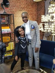 Tiana Sirmans, 7, poses for a picture with actress