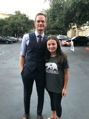"""Silvia Gonzales poses for a photo with NBC's """"Genius Junior"""" host Neil Patrick Harris."""