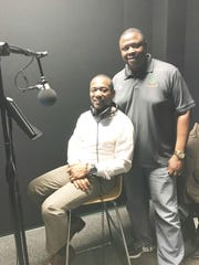 Dr. James Moran, left, provides narration for the highlights on the upcoming documentary. Vaughn Wilson is the sports information at FAMU and executive producer of the film.