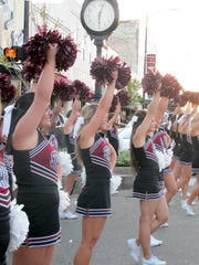 Mississippi State cheerleaders cheer in downtown Starkville in October 2017 the night before  the Bulldogs played Brigham Young University. It was part of the city's New South program, which features different downtown events on the eve of State home football games. (Courtesy of Laura Daniels)