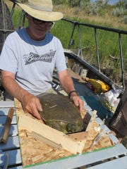 "Steve Leathe invented a ""turtle table"" that helps to control spiny softshell turtles when they are being tagged and measured. ""They are hard to handle,"" said Leathe, NorthWestern Energy's hydro license compliance professional."