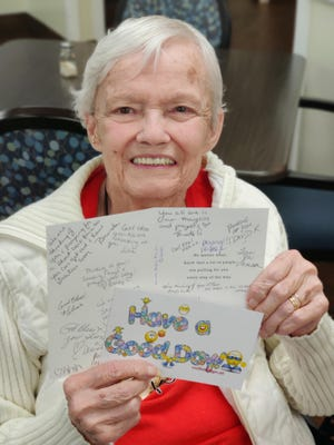 A resident of Grace Manor Suites in North Lakeland shows off a letter she's received in a pen pal program. The facility has received hundreds of letters in response to a pen pal video request in late April. Some letters have included bright, cheery artwork to lift the spirit of residents