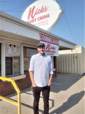 Mike Hartkop outside his latest venture, Nick's Dairy Creme/Solar Roast Coffee, at the corner of Eighth Street and North Erie Avenue.