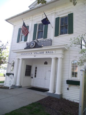 Saugatuck City Hall, 102 Butler St., closed Monday after the announcement of a new epidemic order from the state health department closing restaurant dining rooms and high school and college buildings.