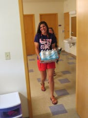 Emma Long of Savannah moves into her dorm at Bethel University on Friday.