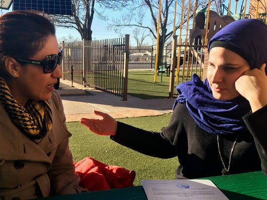 Immigrant Rana Elshekly, 36, left, talks to Qadria