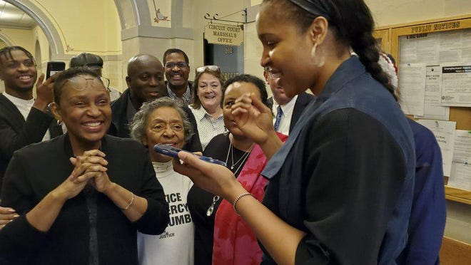 Jefferson City native and WNBA star Maya Moore, right, calls Jonathan Irons as supporters react March 9 in Jefferson City after Cole County Judge Dan Green overturned Irons' convictions in a 1997 burglary and assault case. Moore, a family friend, has supported Irons, sharing his story on a national basis.
