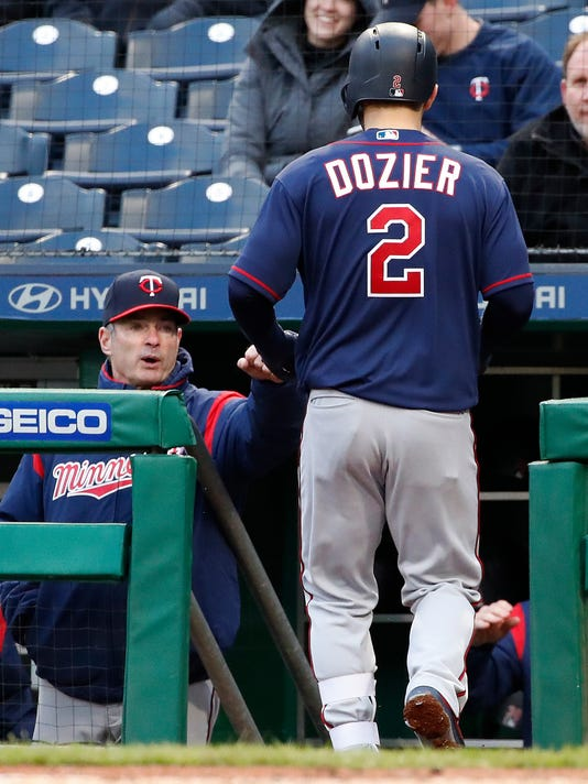 Minnesota Twins' Brian Dozier (2) is greeted by manager Paul Molitor after hitting a solo home run off Pittsburgh Pirates starting pitcher Ivan Nova during the third inning of a baseball game in Pittsburgh, Wednesday, April 4, 2018. (AP Photo/Gene J. Puskar)