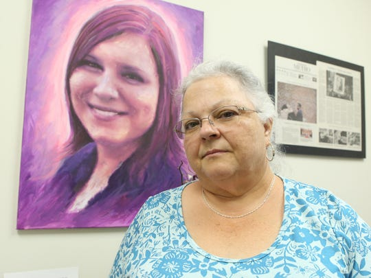 Susan Bro, the mother of Heather Heyer, who was killed in Charlottesville after being struck by a vehicle during the white nationalist riots, poses for a portrait in a room in Heyer's old law office.
