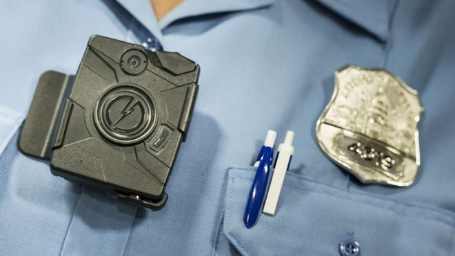 Some officers in a Detroit police precinct wore  body cameras as part of a 90-day trial program. The Mayor's Office said in a news release that all Detroit officers will wear the cameras.