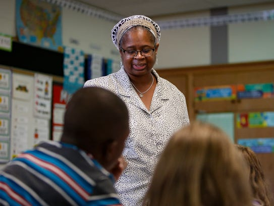 Substitute teacher Ronda Levra works with second-graders