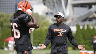 Cincinnati Bengals defensive backs coach Vance Joseph, right, talks with rookie cornerback Josh Shaw during Cincinnati Bengals training camp, Monday, Aug. 10, 2015, on the practice fields adjacent to Paul Brown Stadium.