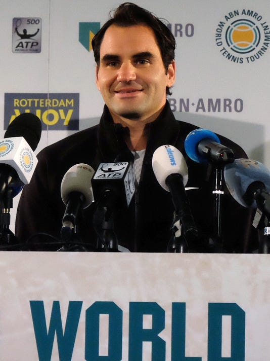 Tennis player Roger Federer faces the media Friday Feb. 16, 2018, in Rotterdam, Netherlands, after becoming ranked as the world number one player.  Federer added another highlight to his age-defying career resurgence Friday, returning to the top of the world rankings for the first time in more than five years and becoming the oldest player to reach the top spot. (AP Photo/Michael C. Corder)