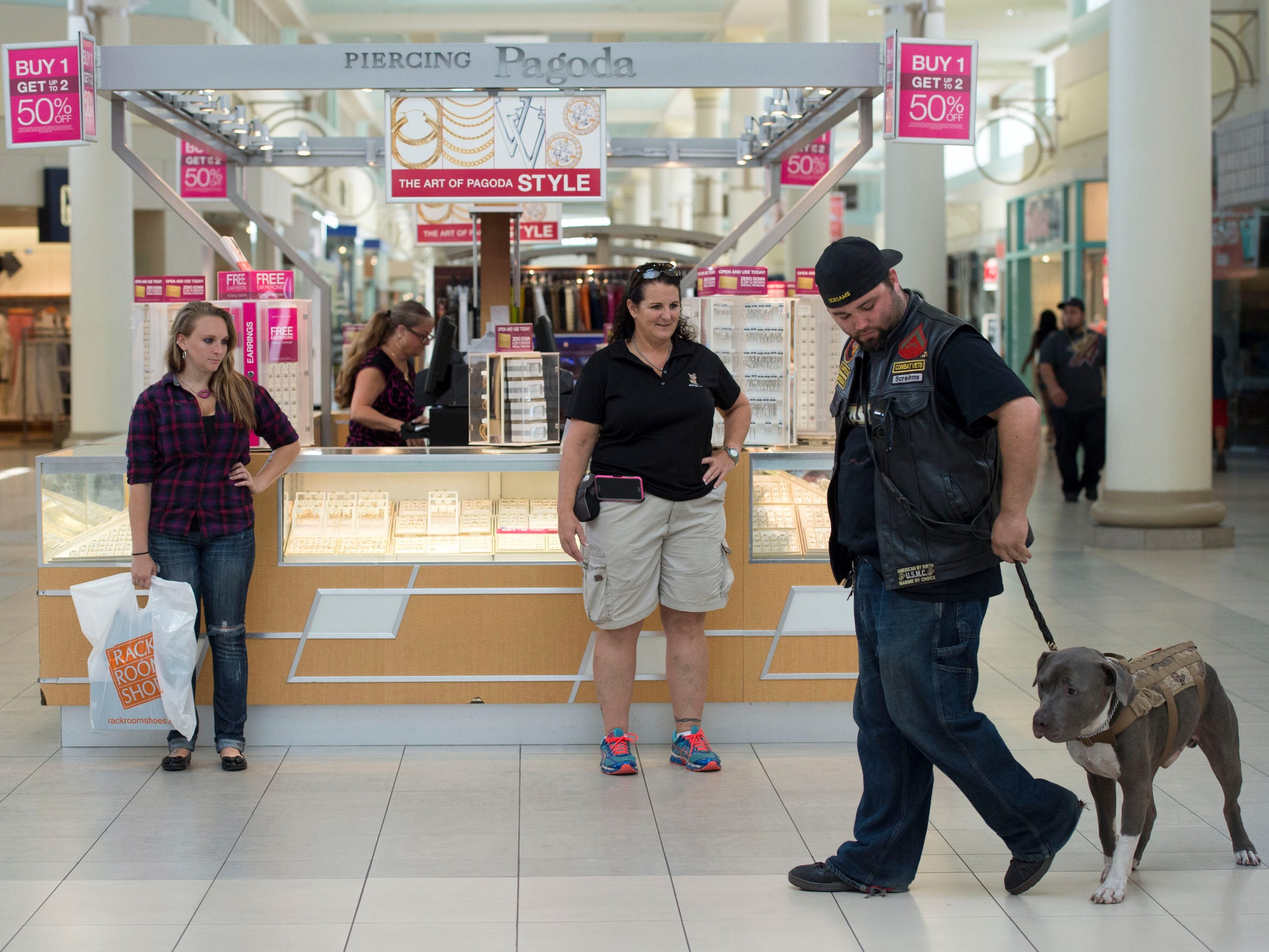 "David Merrill and Recon practice turning on a leash with the guidance of Avatar K-9 trainer Dawn Tait on May 2, 2016, at the Treasure Coast Square mall in Jensen Beach. Merrill has been finding joy in their relationship change, as Recon realizes Merrill will not abandon him. On this day, ""he looked at me from a distance and was just sitting there. When he realized it was me, his whole demeanor got extremely happy and excited,"" Merrill said. ""That felt pretty amazing."""